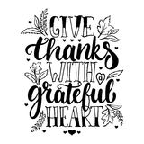 Give thanks with a greatful heart - Thanksgiving day lettering calligraphy phrase with leaves and hearts. Autumn Royalty Free Stock Images