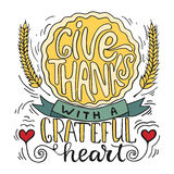 Give thanks with a greatful heart - Thanksgiving day lettering calligraphy phrase with pumpkin pie. Autumn greeting card Stock Image