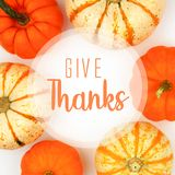 Give Thanks greeting card with frame of pumpkins over white. Give Thanks greeting card with frame of assorted autumn pumpkins over a white background royalty free stock photo
