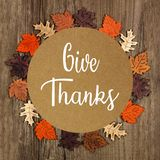 Give Thanks greeting card with frame of wooden autumn leaves royalty free stock images