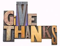 Give thanks - word abstract in wood type. Give thanks - isolated word abstract in vintage letterpress wood type, mixed fonts - Thanksgiving concept stock image