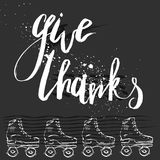 Give Thanks quote handwritten lettering for Thanksgiving Day card. Hand drawn vector ink textured lettering with retro roller skates on black background.Give Stock Images