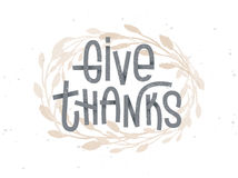 Give Thanks, thanksgiving lettering with a golden wreath Stock Photography