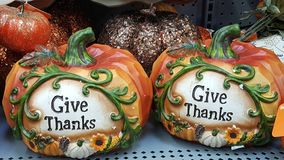 Give thanks. Two pumpkins showing give thanks for Halloween stock photography