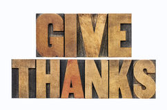 Give thanks in wood type. Give thanks - Thanksgiving concept - isolated text in letterpress wood type royalty free stock photo