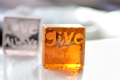 Give thanks. Wording on glass background stock photos