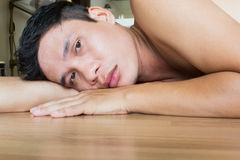 Give Up. Sad Asian Man Lying On The Floor Stock Images