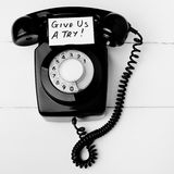 Give us a try new business concept. On a black retro bakelight telephone Royalty Free Stock Photo