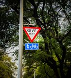 give way for pedestrians and cycle sign board royalty free stock image