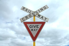 Give way railway crossing sign Stock Photo