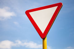 Give Way Road Sign Above Sky Royalty Free Stock Photos