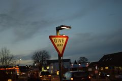 Give way road sign at night. Lit by light at night Stock Photography