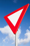 Give Way Road Sign Over Blur Cloudy Sky Stock Photos