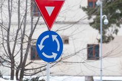 Give way and roundabout traffic sign. S in a small busy town Stock Photos