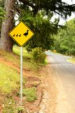 Give way sign for duck. On natural background Royalty Free Stock Photo
