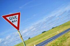 Give way sign on natural background Royalty Free Stock Image