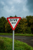 Give Way sign at road junction Royalty Free Stock Photos