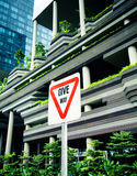Give way sign. Traffic sign over modern buildings background Stock Image