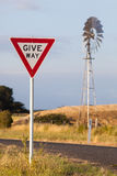 Give way sign and windmill Royalty Free Stock Photo