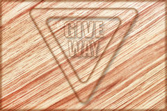 give way sign on wooden board Royalty Free Stock Photos