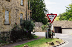 Give way signal traffic in the Cotswolds Royalty Free Stock Photography