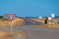 Give Way street sign at on of Australias endless Outback roads stock image