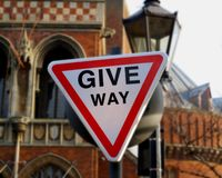 Give way traffic sign in UK English royalty free stock image