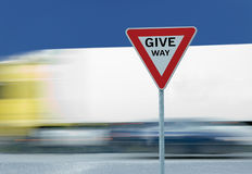 Give way yield traffic sign text and truck Royalty Free Stock Photo