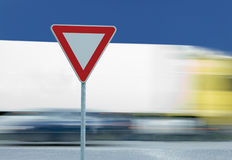 Give way yield traffic sign and truck Stock Photo