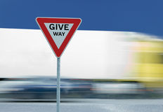 Give way yield traffic sign and truck Royalty Free Stock Photos