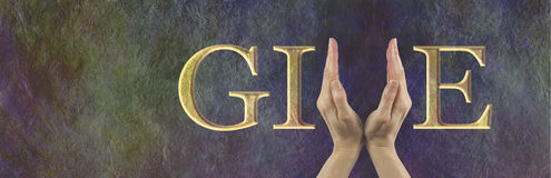 Give what you can fundraising header. Female hands making the V of GIVE on a rustic stone effect banner with copy space on left side Stock Image