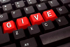 Give word on black keyboard Stock Photos