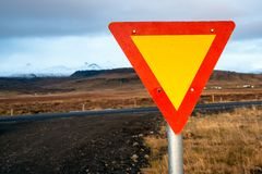 Tringular Give Yield Traffic Sign in Iceland. Give Yield Traffic Sign at an intersection in the Countryside of Iceland on a Rainy Autumn Day royalty free stock image