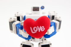 Give you my heart. A robot giving you a heart Stock Photography