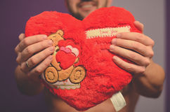 Give you my heart. A young man giving red valentine heart Stock Photo