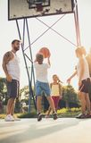 Give it your best. Family playing basketball royalty free stock photography