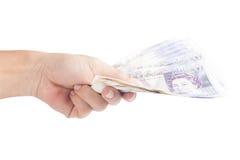 Giveing twenty pound notes Stock Images