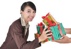 Given a pile of gifts businesswoman smiling Royalty Free Stock Photography