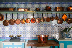 Giverny, France - 20 Oct 2016: inside the home of French impressionist painter Claude Monet. The kitchen with copper pots Royalty Free Stock Image