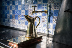Giverny, France - 20 Oct 2016: inside the home of French impressionist painter Claude Monet. The kitchen is equipped with a metal jug on old furnace Royalty Free Stock Photos