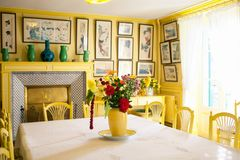 Giverny, France - 20 Oct 2016: inside the home of French impressionist painter Claude Monet. `s yellow dining room Stock Photos