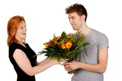 An gives his girlfriend a bouquet of flowers Royalty Free Stock Photos