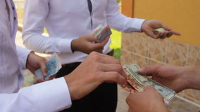 Gives money, The transfer of money from hand to hand stock footage