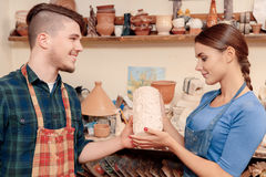 Giving A Vase To The Potter Stock Image