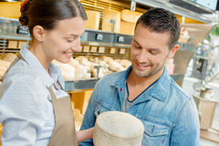 Giving advice in cheese shop Stock Image