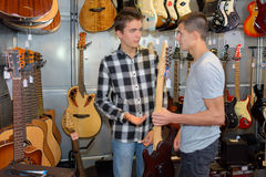 Giving advise about guitar Stock Image