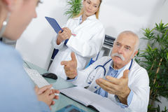 Giving advise to patient. Giving advise to a patient royalty free stock photography