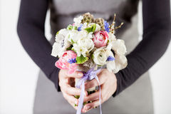 Giving a beautifull spring bouquet Stock Images
