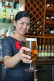 Giving the beer. Smiley bartender Giving the beer royalty free stock images