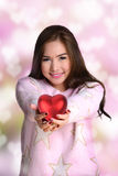 Giving big red heart. Royalty Free Stock Photos